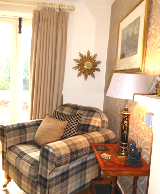 Upholstered-tartan-armchair-with-complementing-cushions