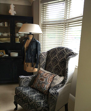 Paisley-upholstered-wingback-armchair-with-matching-cushions