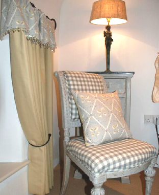 Upholstered-Queen-Anne-Wing-chair-curtain-tiebacks
